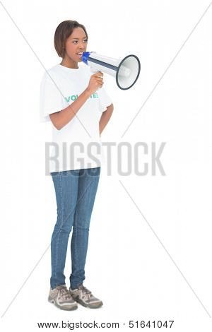 Serious woman shouting in megaphone on white background