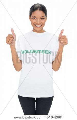Smiling model wearing volunteer tshirt giving thumbs up on white background