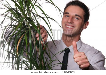 Young Professional Man Holding A Plant