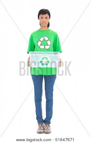 Irritated black haired ecologist holding a recycling box on white background