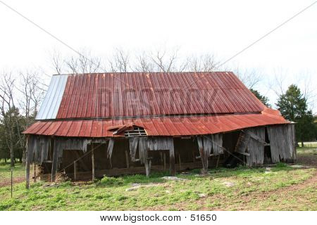Big Dilapidated Red Roofed Barn