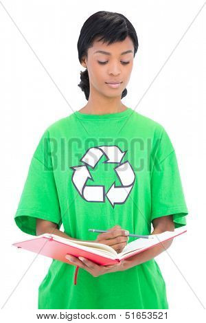 Thoughtful black haired ecologist checking a schedule on white background