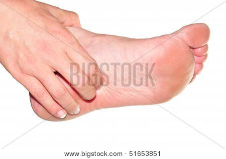 Woman's Hand Being Massaged A Foot