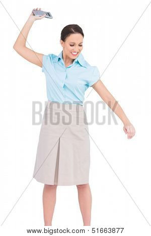 Angry classy businesswoman on white background throwing her calculator