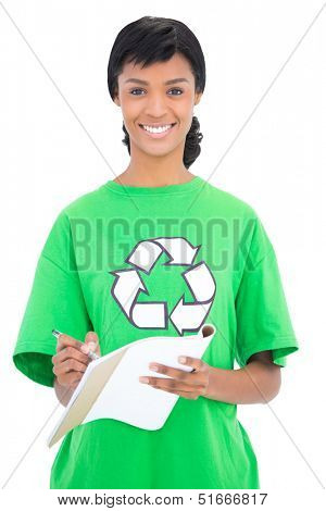 Cheerful black haired ecologist writing on a notebook on white background
