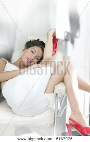 Beautiful Woman Posing Sexy Sit On A Chair