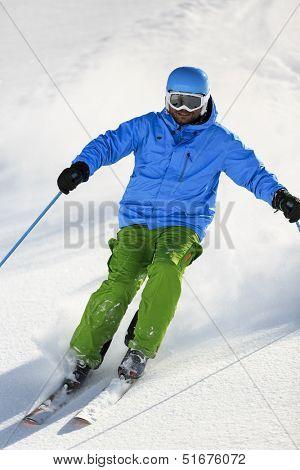 Ski, Skier, Freeride in fresh powder snow - man skiing downhill