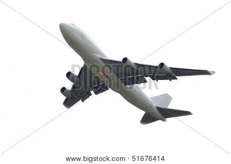 Huge plane taking off to overcast sky