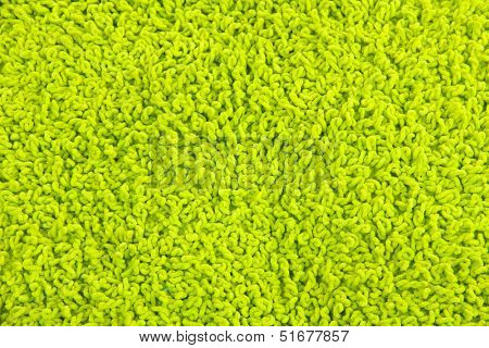 Fleecy green pillow close-up background