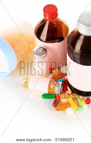 Pills and medicine bottles isolated on white