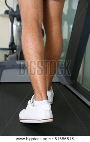 Men leg on treadmill in gym
