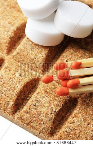 Long matches and dry fuel, close up
