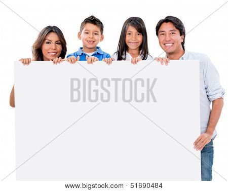 Happy family with a banner ad - isolated over white background