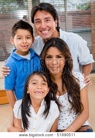 Portrait of a Latin family smiling at home looking very happy