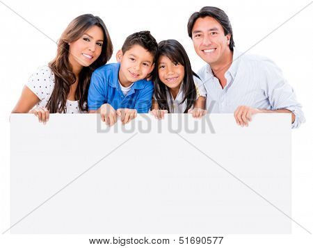 Happy family holding a placard  and smiling - isolated over white