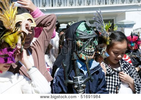 Children disguise oneself as the death going on street.