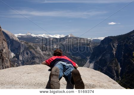 Young Hiker Lying Prone Over Yosemite