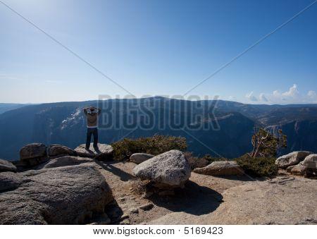 Male Hiker Looking At View From Yosemite Peak