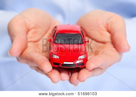 Hand with car. Auto dealership and rental concept background.