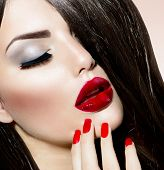 Beauty Girl with Red Lips and Nails. Provocative Makeup. Luxury Woman with Long Brown Smooth Hair. F