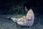 picture of gruesome  - A woman in bloody clothes pretends to be a zombie - JPG