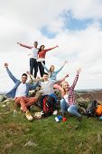 stock photo of 16 year old  - Group Of Young People Hiking In Countryside - JPG