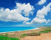 Постер, плакат: Clouds Over San Giovanni Beach