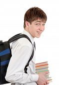 pic of knapsack  - Happy Student with Knapsack Holding the Books Isolated on the White Background - JPG
