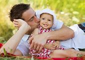 picture of father time  - Happy young father spending time outdoor on a summer day with his beautiful daughter - JPG