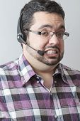 stock photo of rep  - man with headset with scared expression against gray background - JPG