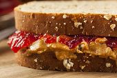 stock photo of whole-wheat  - Homemade Peanut Butter and Jelly Sandwich on Whole Wheat - JPG