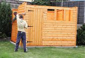 foto of wooden shack  - Building a wooden shed and fixing the sides to the base - JPG