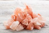 stock photo of crystal salt  - Himalayan crystal salt on wooden background, studio shot ** Note: Shallow depth of field - JPG