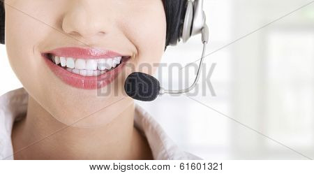 Young call-centre assistant smiling at the camera