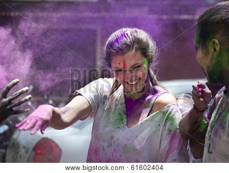 Bangalore, India - Mar 8, 2012: An unidentified young expat lady enjoying Holi festival in India
