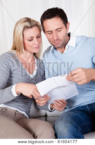 Woman About To Cut Up A Document