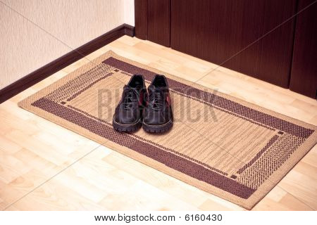The Boots On The Door-mat