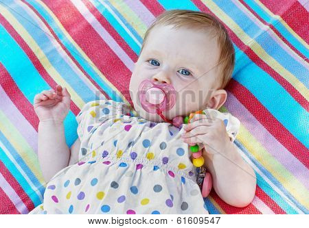 Caucasian Little Baby Girl With Multicolored Frock