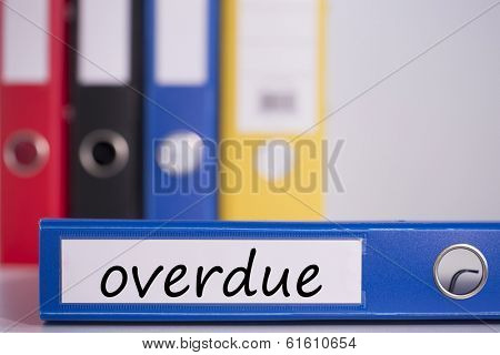 The word overdue on blue business binder