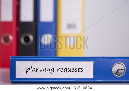 The word planning requests on blue business binder