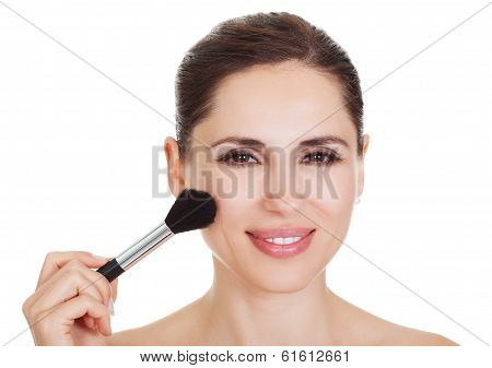 Beautiful Woman Applying Blusher