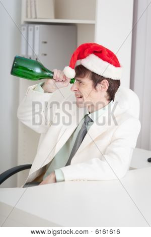 Businessman Celebrates Christmases At Office On Workplace