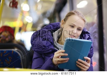 Woman with touchpad in the bus