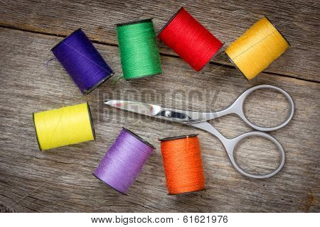 Scissors And Spools Of Colored Thread