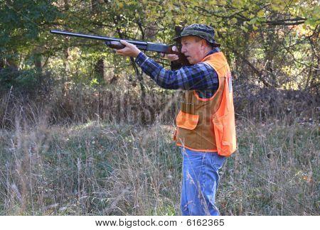 Hunter Shooting A Gun