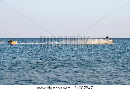 Attraction On The Beach In The Crimea - Jetski Carries Tourists