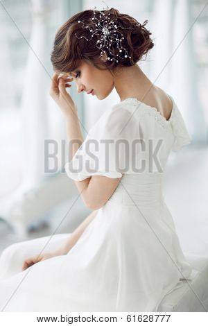 Portrait of beautiful woman in white dress
