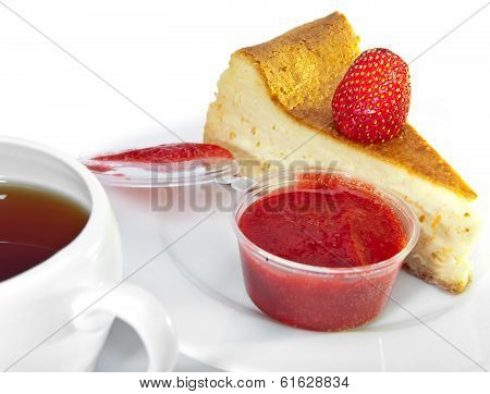 Biscuit with a strawberry and strawberry jam