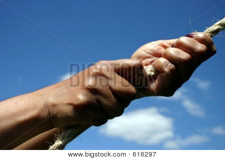 Hands Pulling On Rope