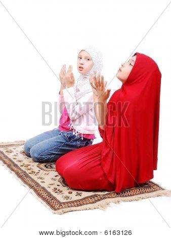 Two Little Muslim Girls Praying